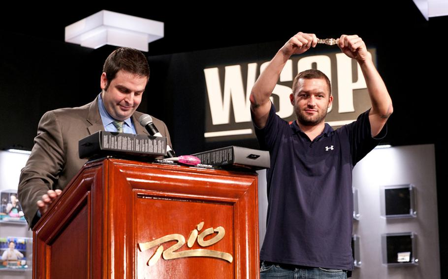 Ken Griffin, right, holds up his World Series of Poker Gold Bracelet after winning Event 45 of the WSOP Championships in Las Vegas. Griffin plans to use a portion of his winnings to help with his ill mother's medical bills.