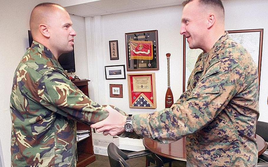 Bulgarian Col. Lavor Mateev, left, meets with Brig. Gen. Charles Chiarotti, deputy commander of Marine Forces Europe, at Panzer Kaserne in Stuttgart, Germany, on Dec. 14, 2011, as part of a three-day planning conference focused on the Marines' upcoming mission in eastern Europe. The Marines' Black Sea Rotational Force, a six-month mission involving 19 countries, launches in March.