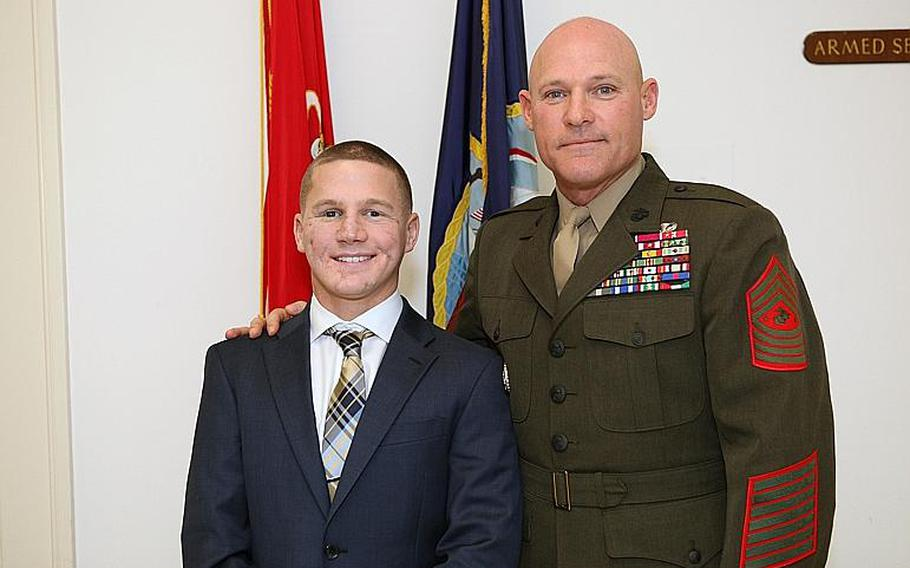 Cpl. William Kyle Carpenter stands beside Sgt. Maj. Micheal P. Barrett, the 17th Sergeant Major of the Marine Corps, in Washington, D.C., on Jan. 23, 2013.