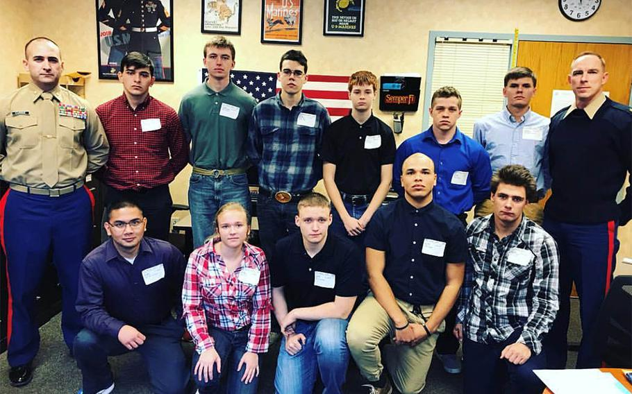 Maj. Brandon Currie, left, and Sgt. Maj. Christopher Lillie, right, with Marine recruits before they headed off to boot camp. Currie and Lillie have been fired from Recruiting Station Cleveland for not fulfilling their recruiting mission, a spokesman for the Marine Corps said Friday.