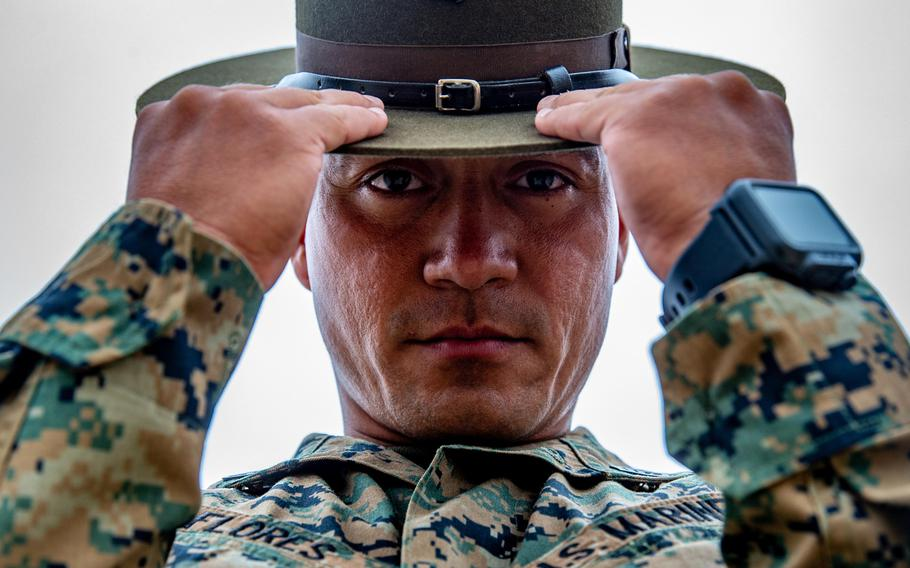 Marine Corps Staff Sgt. Edwin Flores, a drill instructor with Company K, 3rd Recruit Training Battalion, adjusts his campaign cover at Marine Corps Base Camp Pendleton, Calif., in 2018. The Corps has put out a casting call for active duty and reserve Marines to participate in the service's latest recruiting campaign.