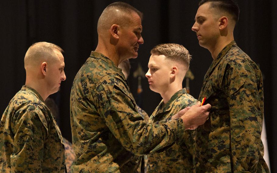 Maj. Gen. Karsten Heckl, second from left, commanding general, 2nd Marine Aircraft Wing, presents Cpl. Timothy Watson with the Navy and Marine Corps Medal at Marine Corps Air Station Cherry Point, N.C., January 28, 2020. Watson along with Staff Sgt. Leary Reichartwarfel, Sgt. Anders Larson and Cpl. Austin McMullen received the award for saving a family at Atlantic Beach, N.C., in 2018.