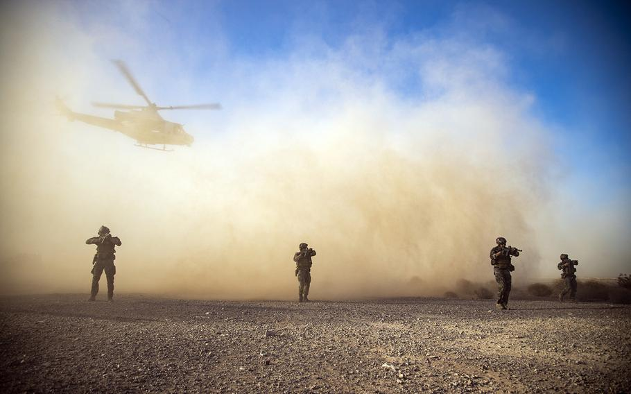 Members of Marine Forces Special Operations Command take part in an exercise during a weapons and tactics course at Yuma Proving Ground, Ariz., Oct. 8, 2019.