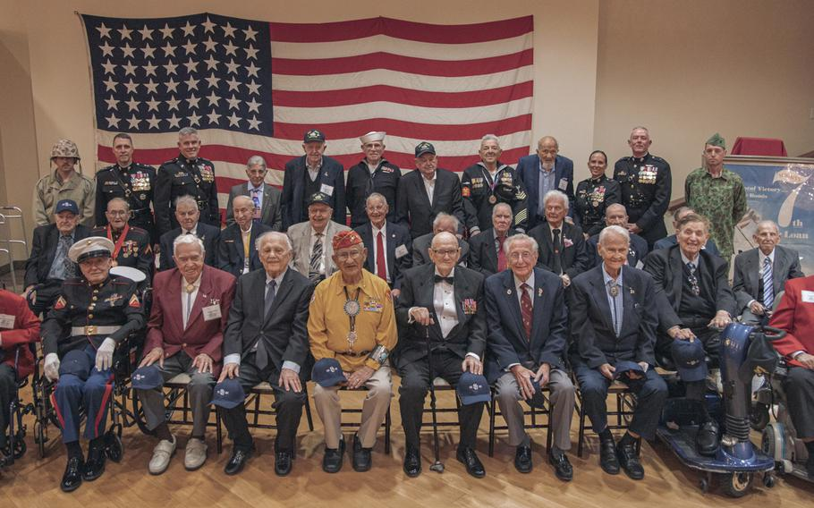 Twenty-eight Iwo Jima veterans and members of the Iwo Jima Commemorative Committee posae for a picture after an event commemoratiing the 75th annivesary of the World War II Battle of Iwo Jima at Marine Corps Base Camp Pendleton, Calif., on Saturday, Feb. 15, 2020.