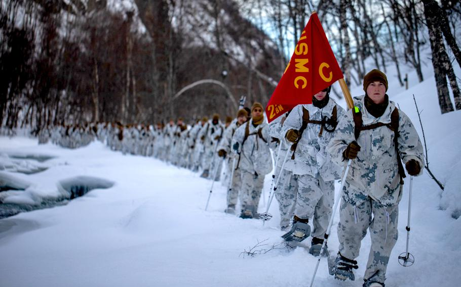 U.S. Marines with Charlie Company, 2nd Law Enforcement Battalion, II Marine Expeditionary Force Information Group, conduct a 3-mile hike using snowshoes during cold-weather training near Bjerkvik, Norway, on Sunday, March 8, 2020. The Marines are in Norway for exercise Cold Response, but the exercise has been canceled because of the new coronavirus outbreak.