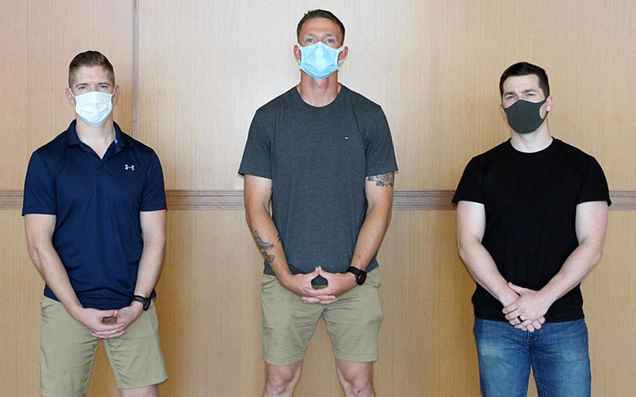 From left, Capt. Daniel Kult, Sgt. John Dietrick and Pfc. Alexander Meinhardt, of 1st Battalion, 6th Marine Regiment, 2nd Marine Division, II Marine Expeditionary Force, pose at Dallas/Fort Worth International Airport, May 4, 2020. The three Marines detained a hostile passenger during a flight from Japan to Texas, a service statement said.