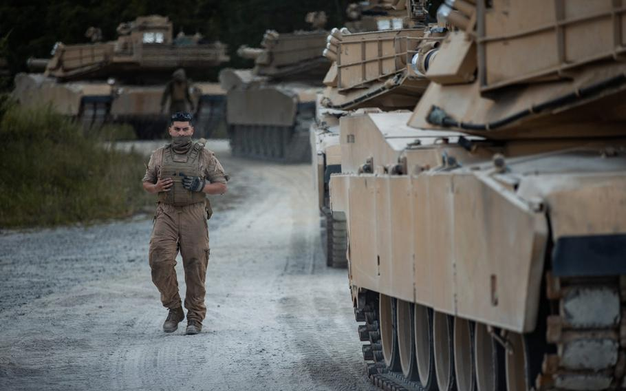A U.S. Marine with 2nd Tank Battalion, 2nd Marine Division ground guides M1A1 Abrams tanks through a tank trail on Camp Lejeune, N.C., July 27, 2020. After serving 2nd MARDIV for more than three-quarters of a century, 2nd Tank Battalion will deactivate as part of the Marine Corps' modernization plan.