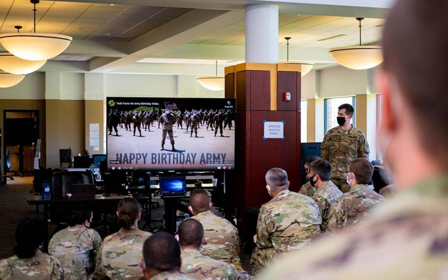 Soldiers in East Lansing, Mich., watch a video celebrating the Army's 245th birthday this year in lieu of the traditional large gatherings.