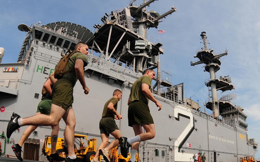 Marines assigned to the 31st Marine Expeditionary Unit run on the flight deck of the forward-deployed amphibious assault ship USS Essex (LHD 2) in 2010.