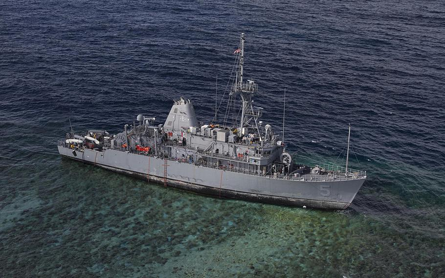 The USS Guardian sits aground on the Tubbataha Reef in the Philippines, Jan. 22, 2013. Work to cut up and remove the ship is expected to begin Friday.