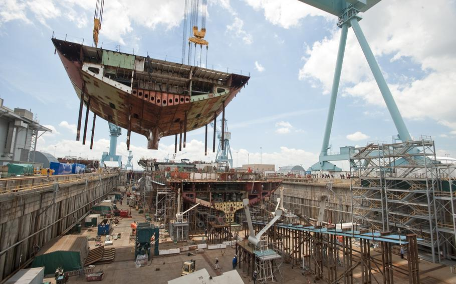 Sections of the aircraft carrier USS Gerald R. Ford are moved into position at Huntington Ingalls Newport News Shipbuilding in this 2011 photo.