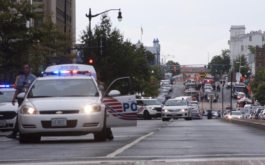 Police respond to the scene of a shooting at the Washington Navy Yard that left 12 people dead on Sept. 16, 2013.