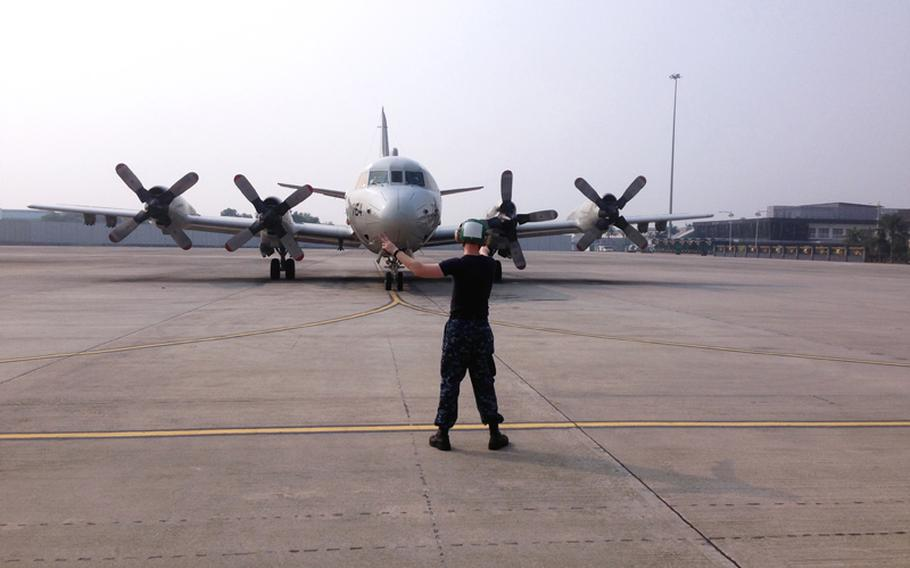 A U.S. Navy P-3C Orion prepares to depart in search of the missing Malaysian Airlines flight MH370 in the Gulf of Thailand. The flight had 227 passengers from 14 nations, mainly China, and 12 crew members. According to the Malaysia Airlines website, three Americans, including one infant, were also aboard.
