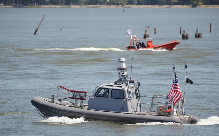 This Tuesday Aug. 12, 2014 photo provided by the U.S. Navy shows an unmanned 11-meter rigid hulled inflatable boat (RHIB) from Naval Surface Warfare Center Carderock, as it operates autonomously during an Office of Naval Research demonstration of swarmboat technology held on the James River in Newport News, Va.