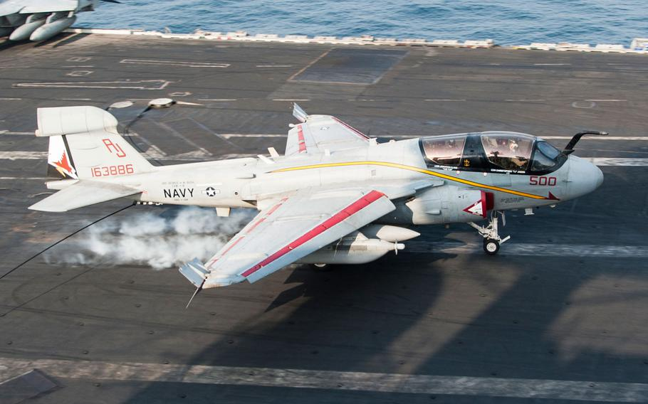An EA-6B Prowler assigned to the Garudas of Electronic Attack Squadron (VAQ) 134 lands on the flight deck of the aircraft carrier USS George H.W. Bush. George H.W. Bush is supporting maritime security operations, strike operations in Iraq and Syria as directed, and theater security cooperation efforts in the U.S. 5th Fleet area of responsibility.