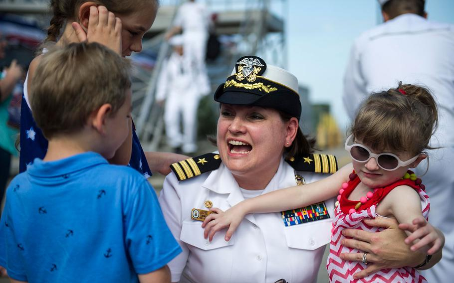 Cmdr. Alysa L. Ambrose Mansfield, commanding officer of the Arleigh Burke-class guided-missile destroyer USS Gravely, greets her family during a homecoming celebration at Naval Station Norfolk on July 13, 2016.