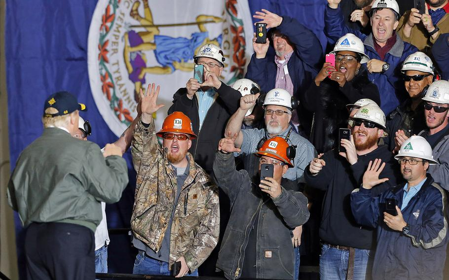 President Donald Trump acknowledges the crowd after speaking abroad the aircraft carrier Gerald R. Ford at Newport News Shipbuilding, March 2, 2017.
