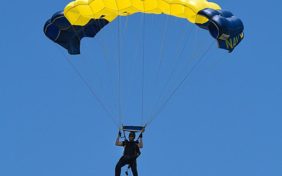 Petty Officer 1st Class Remington Peters, a member of the U.S. Navy Parachute Team, the Leap Frogs, comes in for a landing during a demonstration at the Dayton Air Show.