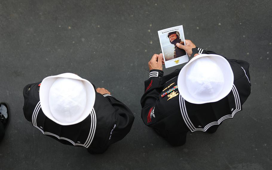 Sailors attend a memorial ceremony for Petty Officer 1st Class (SEAL) Remington Peters at Naval Amphibious Base Coronado, Calif., on June 2, 2017.