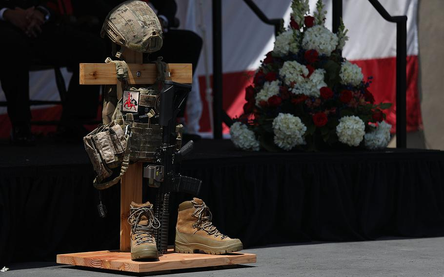 A battlefield cross is displayed in honor of Petty Officer 1st Class (SEAL) Remington Peters during a memorial ceremony at Naval Amphibious Base, Coronado on June 2, 2017.