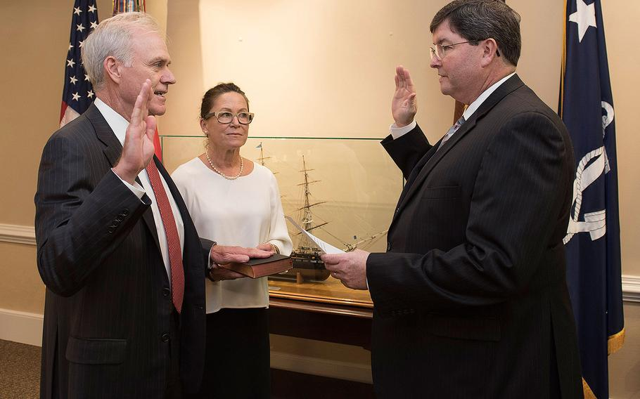 Richard V. Spencer is sworn in as the 76th Secretary of the Navy on Thursday, Aug. 3, 2017 by William O'Donnell, Department of the Navy administrative assistant.