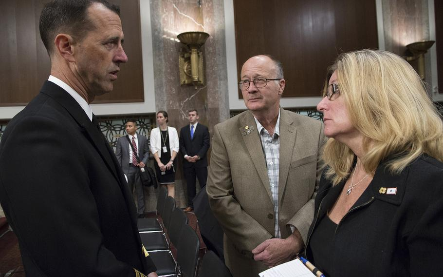 Chief of Naval Operations Adm. John M. Richardson talks with Sid and Theresa Palmer of Decatur, Ill., parents of Petty Officer 3rd Class Logan Palmer, before a Senate Armed Services Committee hearing on Capitol Hill, Sept. 19, 2017. Logan Palmer was one of 10 sailors who died in a collision between the USS John McCain and a tanker near Singapore on August 21.