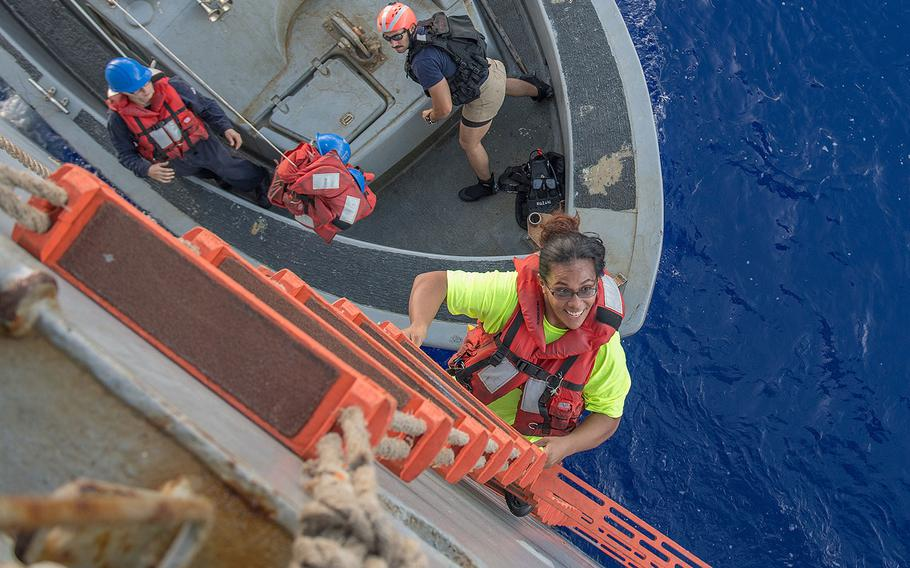 Tasha Fuiaba, an American mariner who had been sailing for five months on a damaged sailboat, climbs the accommodation ladder to board the amphibious dock landing ship USS Ashland on Oct. 25, 2017.