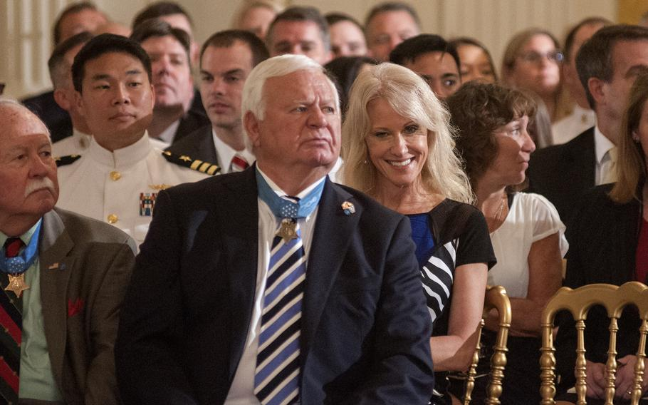 Counselor to the President Kellyanne Conway sits behind Medal of Honor recipients Michael Thornton and Barney Barnum, at left, prior to the start of a Medal of Honor ceremony at the White House in Washington, D.C., on Thursday, May 24, 2018.