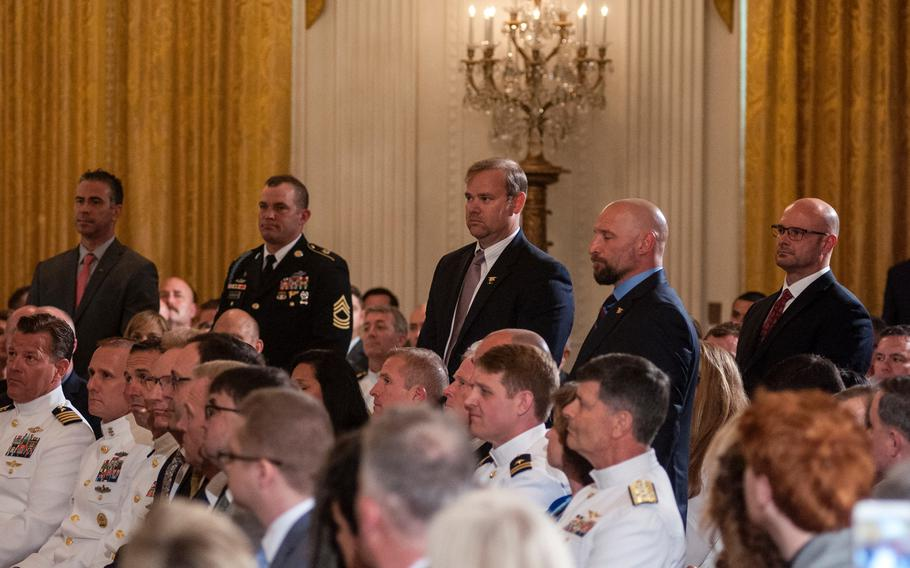 """During a ceremony Thursday, May 24, 2018, at the White House, where retired Navy SEAL Master Chief Petty Officer Britt Slabinski received the Medal of Honor for his actions during a March 2002 Afghanistan battle, President Donald Trump recognized seven other members of Slabinski's Special Forces team, five of whom stood to be recognized. The seven named were Petty Officer 2nd Class Brett Morganti, Chief Warrant Officer Kyle Soderberg, Petty Officer 2nd Class Stephen Toboz, Chief Warrant Officer Al Mack, Sergeant Christopher Cunningham, Master Sergeant Eric Stebner and an unnamed Master Chief Petty Officer still on active duty who was """"quietly not with us today,"""" said the president."""