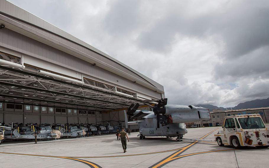 Marines park an MV-22 Osprey aircraft inside Hangar 7 at Marine Corps Air Station (MCAS) Kaneohe Bay on Aug. 22, 2018 ahead of Hurricane Lane.