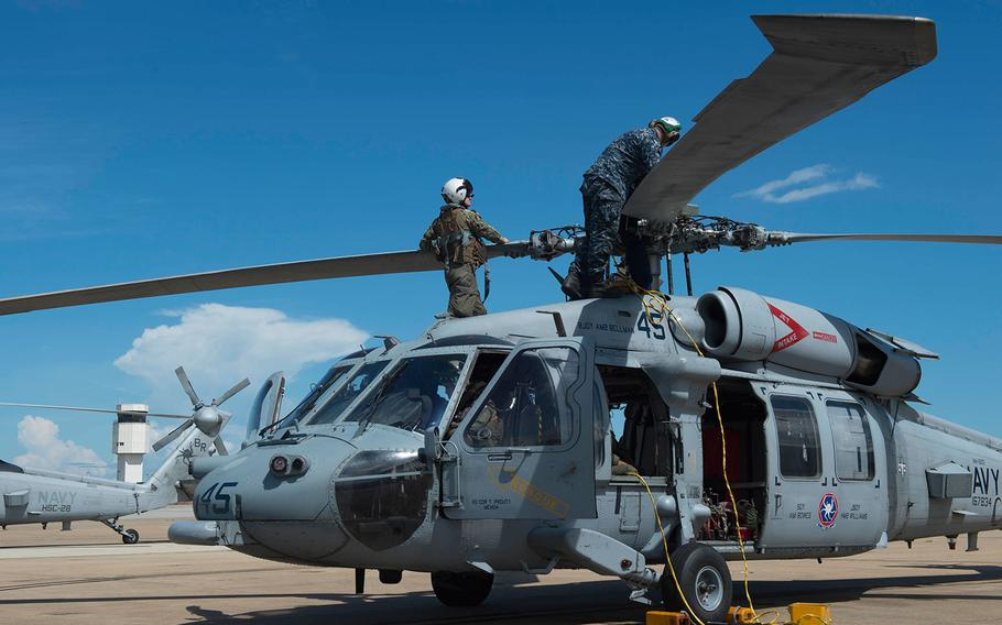 In anticipation of the arrival of Hurricane Florence, Sailors of Helicopter Sea Combat Squadron (HSC) 28 prepare MH-60S Sea Hawk helicopters to evacuate Naval Station Norfolk on Sept. 11, 2018.