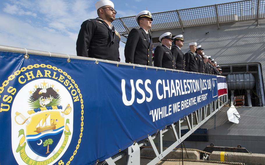 The crew of the Navy's newest littoral combat ship, USS Charleston (LCS 18), mans the rails and brings the ship to life during the ship's commissioning ceremony in Charleston, S.C., on Saturday, March 2, 2019.