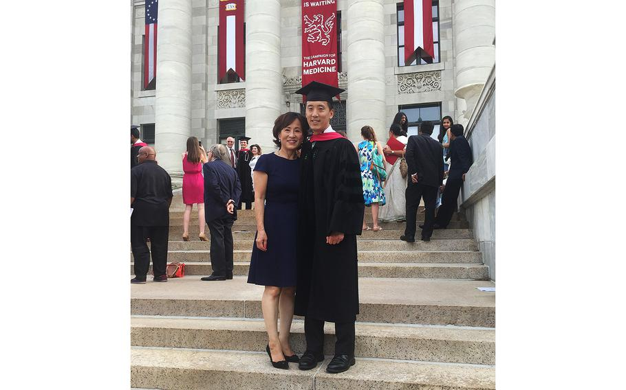 Former enlisted Navy SEAL Jonny Kim – now a lieutenant in the Navy Reserve who completed astronaut training Jan. 10, 2020 – is seen in his graduation cap and gown at Harvard University.