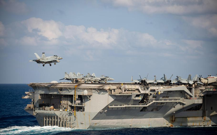 An F/A 18F Super Hornet lands on the flight deck of the USS Theodore Roosevelt (CVN 71) March 18, 2020, while the aircraft carrier was transiting the Philippine Sea.