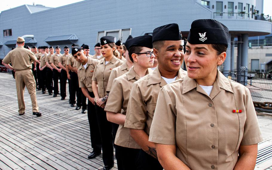 Sailors stand in formation onboard the USS Wisconsin (BB-64) prior to their group reenlistment on Jan. 30, 2020.