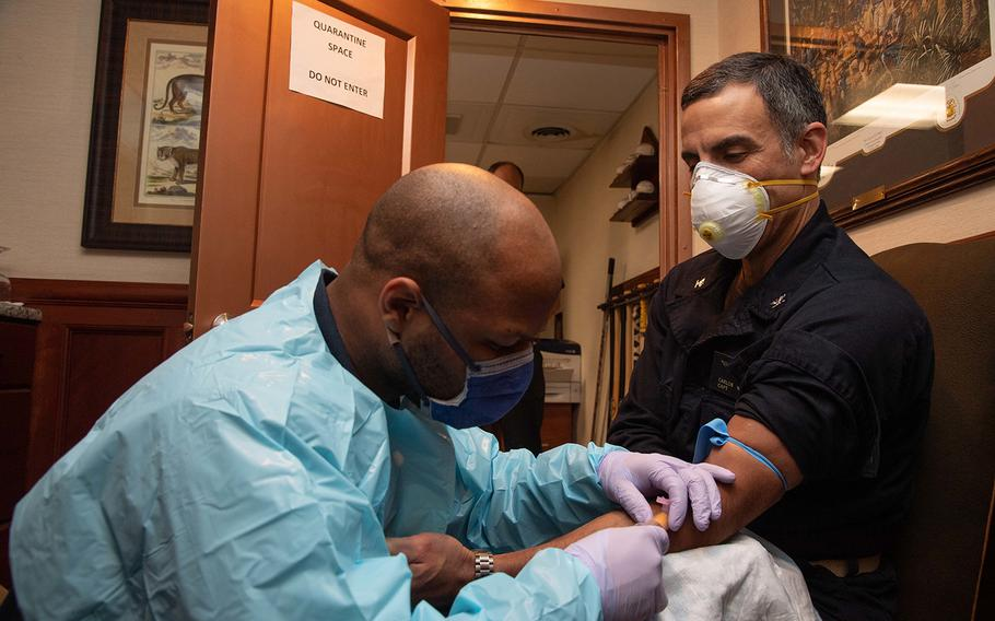 U.S. Navy Capt. Carlos Sardiello, commanding officer of the aircraft carrier USS Theodore Roosevelt (CVN 71), gives blood for a serology study aimed at identifying antibodies associated with COVID-19 aboard the ship on April 22, 2020.