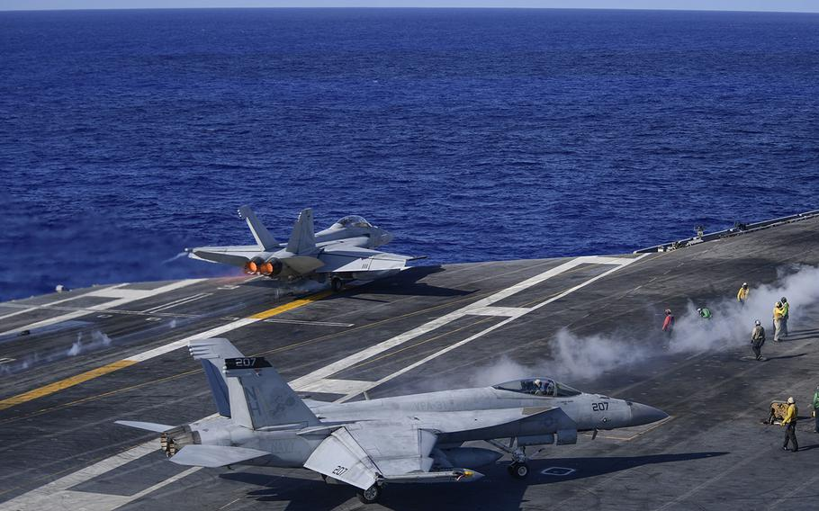 """An F/A-18F Super Hornet assigned to the """"Black Knights"""" of Strike Fighter Squadron (VFA) 154 launches from the flight deck of the aircraft carrier USS Theodore Roosevelt on Friday, June 12, 2020. The Theodore Roosevelt Carrier Strike Group is on a scheduled deployment to the Indo-Pacific region."""