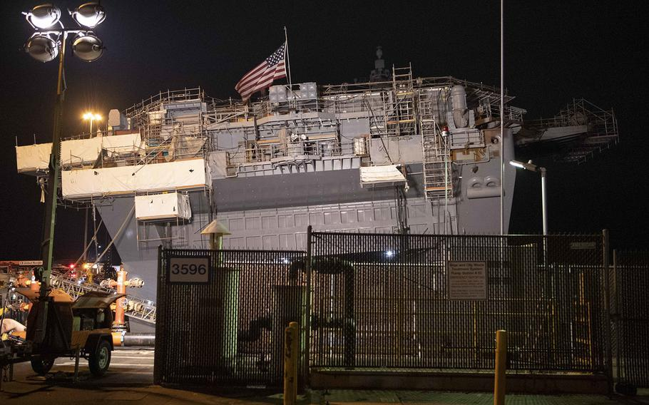 """Damage control efforts continue on board the amphibious assault ship USS Bonhomme Richard on Thursday, July 16, 2020. Crews were cleared from the ship and the pier at Naval Base San Diego, Calif., """"due to an initial shift in the ship's list."""""""
