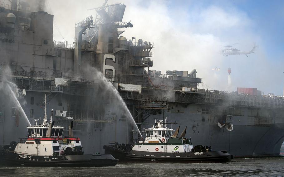 Fire crews battle a blaze aboard the amphibious assault ship USS Bonhomme Richard at Naval Base San Diego, July 13, 2020.