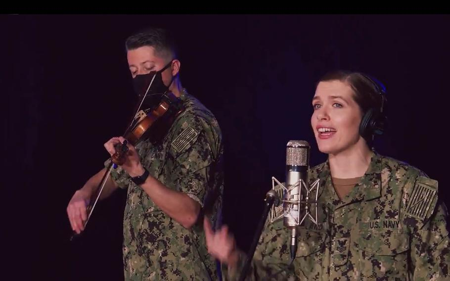 """Members of the U.S. Navy Band perform a sea-shanty version of Taylor Swift's """"We Are Never Ever Getting Back Together"""" in this screenshot from a video posted to Twitter, Monday, Jan. 25, 2021."""