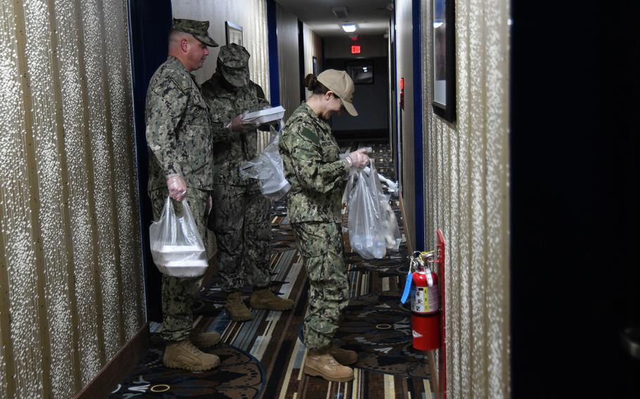 Sailors deliver meals to personnel in a Restriction of Movement status at Naval Air Facility Misawa on March 26, 2020.