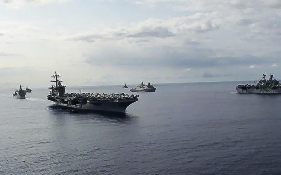 A video screen grab shows Ships from the Theodore Roosevelt Carrier Strike Group, the America Expeditionary Strike Group, and the U.S. 7th Fleet command ship, USS Blue Ridge (LCC 19), transit the Philippine Sea on March 24, 2020. The Roosevelt's commanding officer, Capt. Brett Crozier, has alerted the Navy that the aircraft carrier is facing a growing outbreak of the coronavirus.