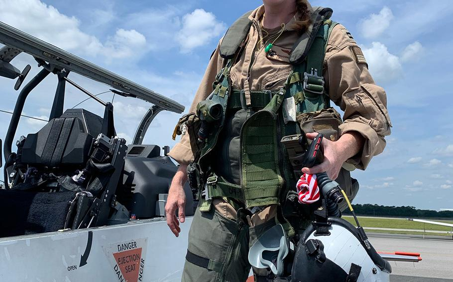 U.S. Navy Lt. Rhiannon Ross, an instructor pilot, stands in front of a T-6B Texan II primary flight trainer aircraft at Naval Air Station Whiting Field in Milton, Fla., in an undated photo. Ross and U.S. Coast Guard Ensign Morgan Garrett, a student naval aviator, died Oct. 23, 2020 when their aircraft crashed in Foley, Ala.