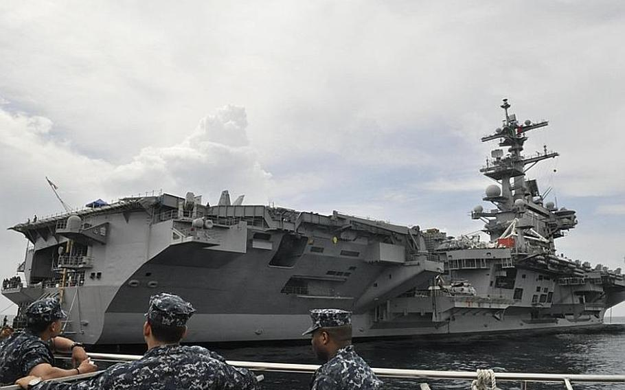 Sailors aboard a transport ferry Saturday were among the first from the aircraft carrier USS George H.W. Bush to hit dry land. The Bush pulled into the port of Naples, Italy, for a visit on its maiden deployment.