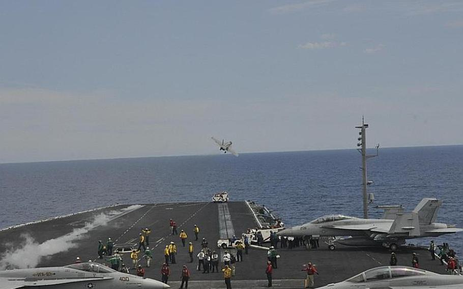 A jet catapults off the runway of the aircraft carrier USS George H.W. Bush on Friday in the Mediterranean Sea. The Bush is on its maiden deployment as the flagship of a carrier strike group.