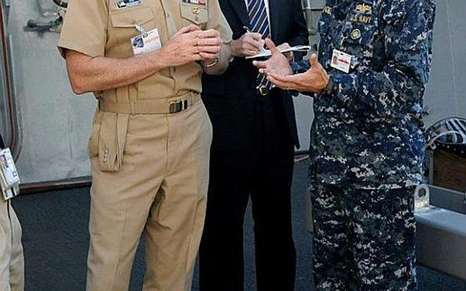 Chief of Naval Operations Adm. Jonathan Greenert, left, speaks with Cmdr. Jon Haydel, former commanding officer of the Pre-Commissioning Unit San Diego during a tour of the ship in October at the Huntington Ingalls Shipyard in Pascagoula, Miss. Haydel was relieved of duty Monday while allegations of personal misconduct are investigated.