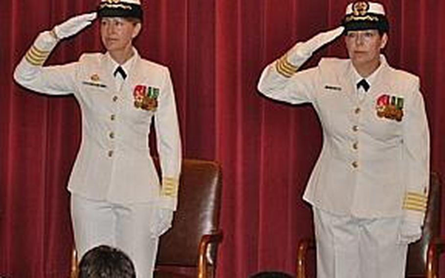 Capt. Marcia Lyons, right, takes command of Naval Health Clinic New England from Rear Adm. Elaine Wagner during a 2010 ceremony. Wagner relieved Lyons on April 6, 2012, after problems were identified in an annual command climate survey.