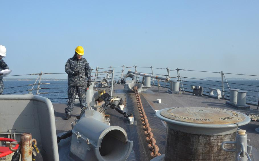 A sailor from the destroyer USS Curtis Wilbur observes as the anchor drops while at sea, east of Japan, during preparations for a Navy Board of Inspection and Survey review. The destroyer is 1 of the Navy's ballistic missile defense-capable ships based in Japan and could be among the 1st to know if North Korea were to launch a ballistic missile.
