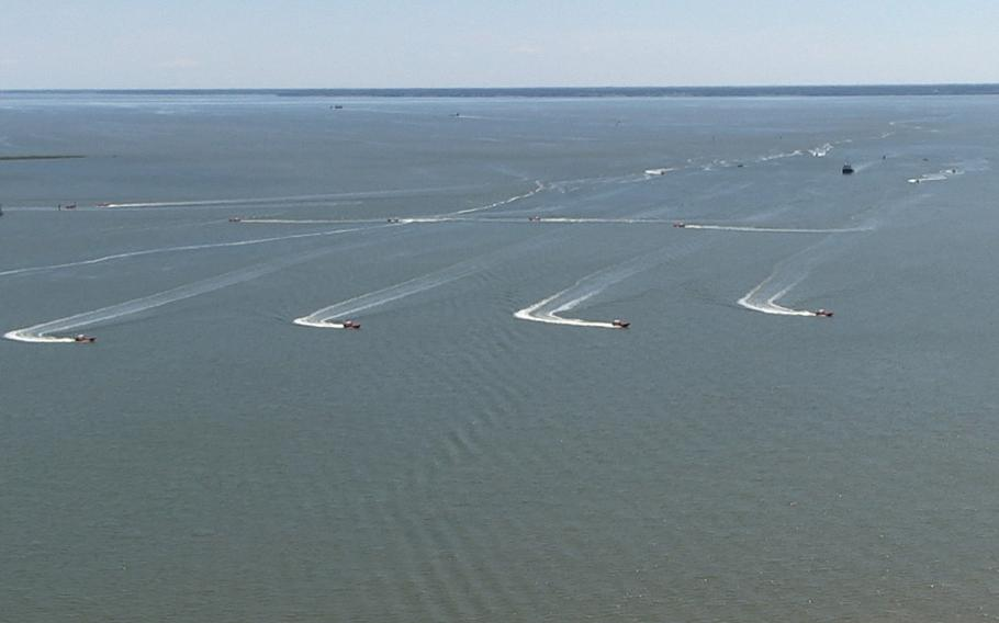 In a screen capture from video, eight unmanned high-speed maneuvering surface targets (HSMSTs) move to their blocking positions during an Office of Naval Research (ONR)-sponsored demonstration of autonomous swarmboat technology held on the James River in Newport News, Va. During the demonstration as many as 13 Navy boats, using an ONR-sponsored system called CARACaS (Control Architecture for Robotic Agent Command Sensing), operated autonomously or by remote control during escort, intercept and engage scenarios.