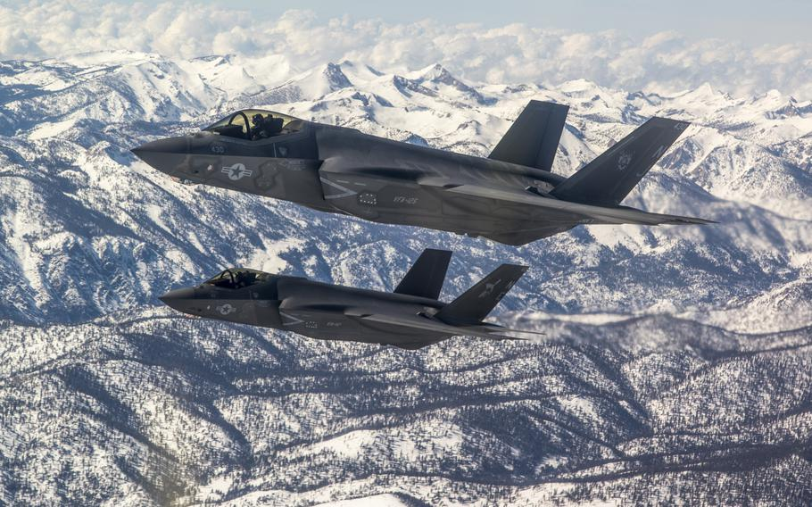 Two F-35C Lightning II aircraft from Naval Air Station Lemoore, Calif., fly in formation over the Sierra Nevada Mountain Range after completing a training mission in February 2019. Two pilots recently were the first to graduate from the Navy Strike Fighter Tactics Instructor course, popularly known as TOPGUN, while flying F-35C jets.